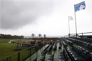 Empty seats on the 18th hole as rain stops play for the day during Round 1 of the South African Open.