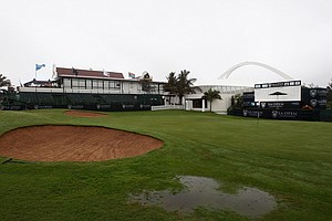 The 18th green seen flooded as rain stops play for the day during Round 1 of the South African Open.