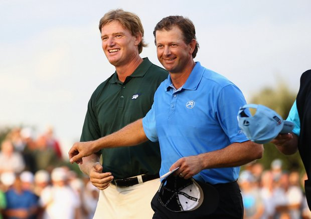 Ernie Els is congratulated by Retief Goosen after the final round of the South African Open.