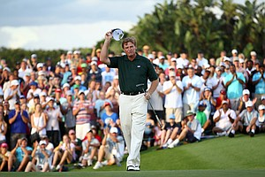 Ernie Els celebrates after his final putt on the 18th green to win the South African Open.