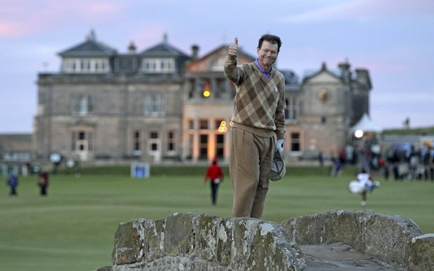 Tom Watson of the U.S. stands on the Swilken Burn bridge and gives the thumbs up on his final round at St. Andrews, during the second round of the British Open Golf Championship on the Old Course at St. Andrews, Scotland, Friday, July 16, 2010.