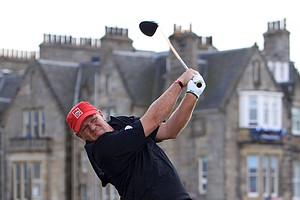 John Daly of the U.S. hits his tee shot on the second hole during the third round of the British Open Golf Championship on the Old Course at St. Andrews, Scotland, Saturday, July 17, 2010.