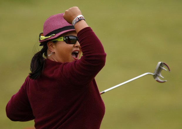 Christina Kim of the USA reacts after making a putt for eagle on the eighteenth hole during the third round of the Womens British Open, at Royal Birkdale Golf Club, Southport, England, Saturday July 31, 2010.