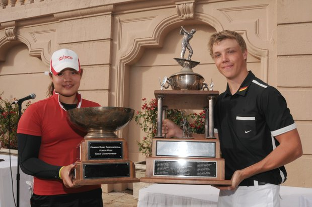 At left, Ariya Jutanugarn shows off her trophy after winning the Junior Orange Bowl International title on Dec. 30, 2010 at the Biltmore Country Club in Coral Gables, Fla. At right, Max Rottluff is all smiles after beating American Curtis Thompson in a one-hole playoff to win the boys title.