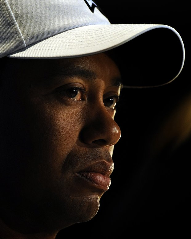This Nov. 10, 2010, file photo shows Tiger Woods at a news conference after his round at the Australian Masters Pro-Am event at Victoria Golf Club in Melbourne, Australia. Woods believes he finally is ready to move on after a self-destructive year that cost him his marriage, his mystique, millions in endorsements and, lastly, his No. 1 ranking. What remains are relationships to repair, along with his golf game.