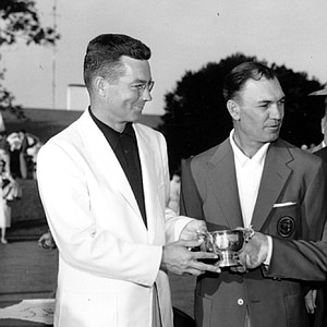 Bobby Jones (right) presents the silver cup trophy to Billy Joe Patton, the low amateur in the 1954 Masters Tournament at Augusta National Golf Club. Patton, who died Jan. 1 at age 88, finished one stroke out of a playoff between Ben Hogan (second from left) and champion Sam Snead (background).