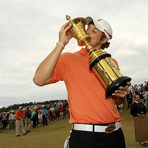 Oklahoma State junior Peter Uihlein kisses the Havemeyer Trophy after winning the U.S. Amateur at Chambers Bay. He is No. 1 in the Golfweek/Sagarin College Rankings.