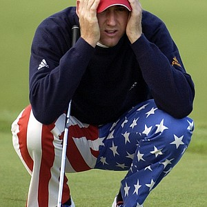 Ian Poulter, of England, lines up a putt on the 10th green during the first round the 2004 PGA Championship at Whistling Straits in Haven, Wis.