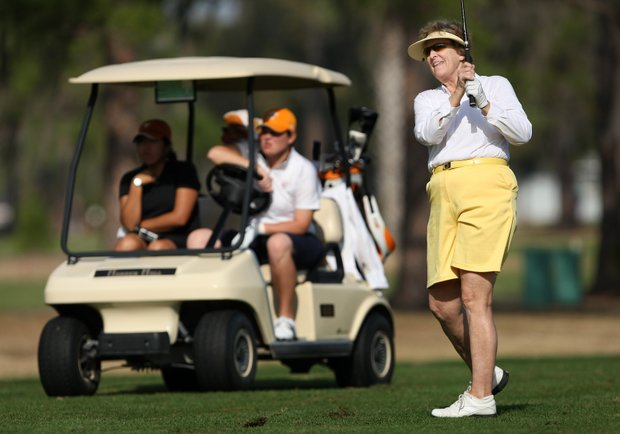 Carol Semple Thompson, tournament chairman, hits her second shot at No. 1.