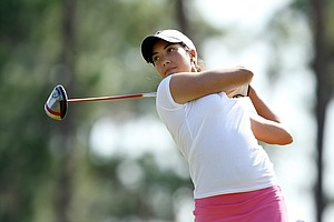 Cheyenne Woods hits her tee shot at No. 17. Woods, the niece of Tiger Woods, is a Wake Forest student.