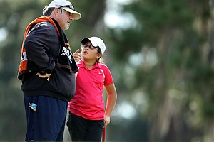 Latanna Stone, 9, talks with her father/caddie, Michael, during the opening round. Stone is the youngest competitor in the field.