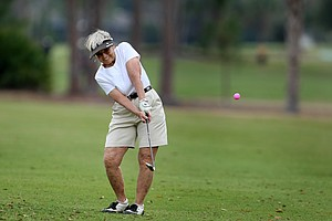 Nancy Newberry of Burnsville, N.C. hits a shot during the opening round. Newberry has played in the tournament for 30 years.