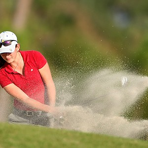 Paige Moffat of Avon Park, Fla., hits a bunker shot at No. 7.
