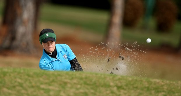 Aimee Neff, of Carmel, Ind., hits out of a bunker at No. 7.
