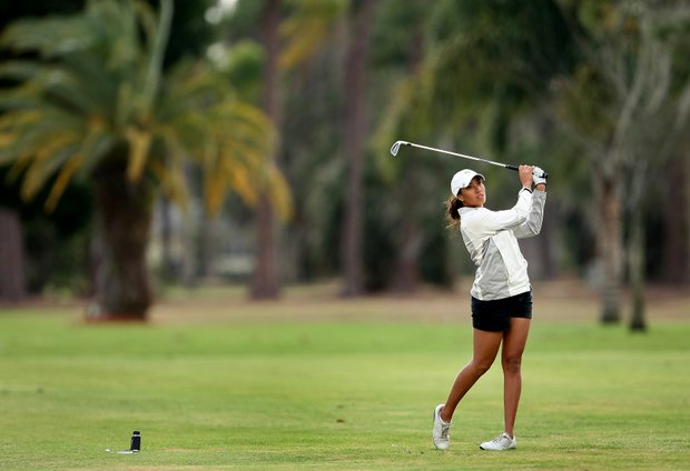 Cheyenne Woods, a junior at Wake Forest, hits her second shot at No. 8. Woods began the third round with a four-shot lead.