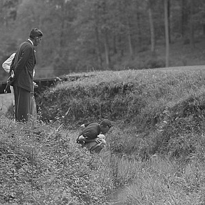 Billy Joe Patton searches for his ball in the creek at hole No. 13 in the final round of the 1954 Masters.