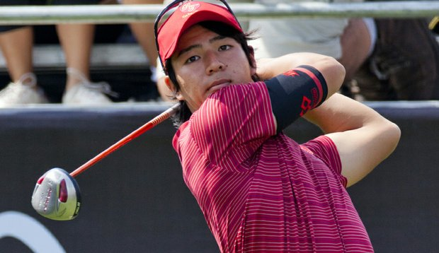 Ryo Ishikawa of Japan plays a shot on the first hole during day one of The Royal Trophy tournament at Black Mountain Golf Club on January 7, 2011 in Hua Hin, Thailand.