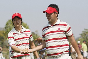 Ryo Ishikawa, left, and Shunsuke Sonoda shake hands after finishing the 7th hole during their fourball Royal Trophy match against Europe on Saturday, Jan. 8. Asia swept the day's matches.