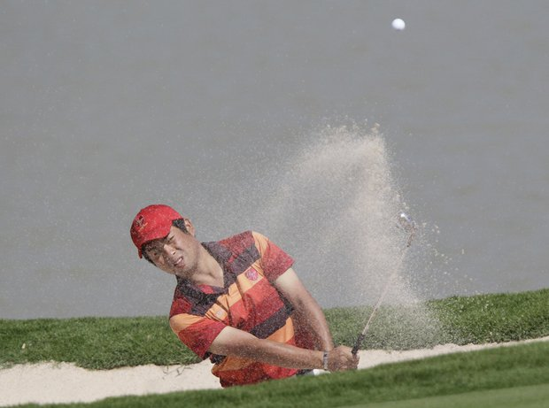 Asia team's Yuta Ikeda of Japan hits from a bunker on the 10th hole Sunday, Jan. 9, at the Black Mountain Golf Club in Hua Hin, Thailand.