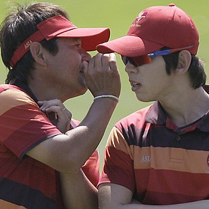 Asia team captain Naomichi Ozaki, left, gives some advice to Seung-yul Noh of South Korea on the 10th hole Sunday at the 2011 Royal Trophy.
