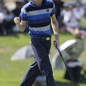 Europe's Rhys Davies of Wales reacts after sinking a putt on the 10th green Sunday at the 2011 Royal Trophy.