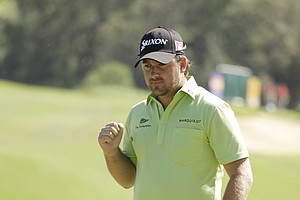 Graeme McDowell celebrates after opening with birdie during the final round.