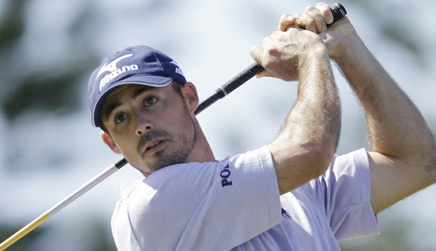 Jonathan Byrd tees off on the third hole during the final round of the Hyundai Tournament of Champions golf tournament in Kapalua, Hawaii on Sunday, Jan. 9, 2011.