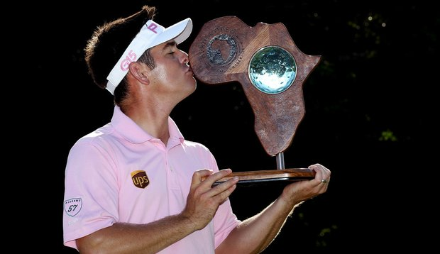 Louis Oosthuizen kisses the trophy after winning the 2011 Africa Open.