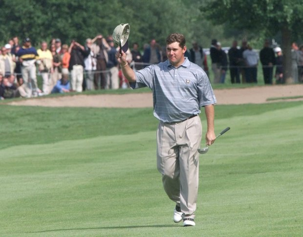 British golfer Lee Westwood waves to the crowd during the final round of the Deutsche Bank open golf tournament at Gut Kaden in Alveslohe, near Hamburg, northern Germany, on Sunday, May 21, 2000. Westwood won the tournament .