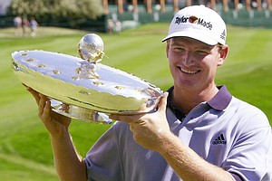 South African golfer Ernie Els is all smiles as he shows off his trophy after winning the Qwest International Golf Tournament in Castle Rock, Colo., on Sunday, Aug. 6, 2000. Els picked up a check for $630,000 for the win.