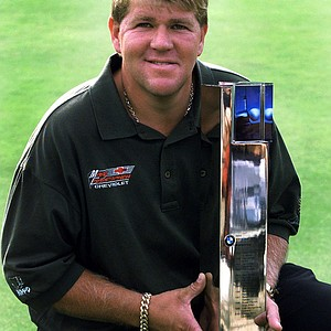 U.S. golfer John Daly poses with the trophy after winning the BMW International Open golf tournament in Eichenried near Munich in southern Germany on Sunday, Sept. 2, 2001. It was his first victory since winning the British Open in 1995.