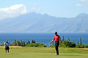 Ernie Els urges his ball closer to the third hole of the Plantation Course during second round play of the Mercedes Championships in Kapalua, Hawaii, Friday, Jan. 10, 2003. Els was attempting a birdie putt. In the backgroun