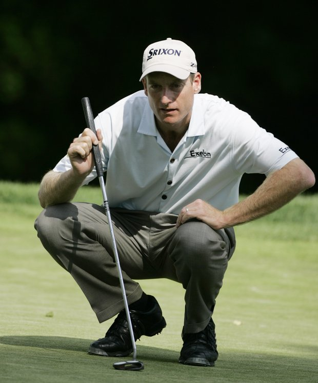 Jim Furyk lines up a putt on the third hole in the second round of the U.S. Open at Winged Foot Golf Club on Friday, June 16, 2006, in Mamaroneck, N.Y. Furyk made birdie on the hole.