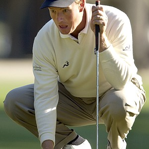 Ernie Els, of South Africa, lines up a putt on the third green Monday, April 16, 2007, during the final round of the Verizon Heritage golf tournament in Hilton Head Island, S.C. Els finished second, one stroke behind winner Boo Weekley.