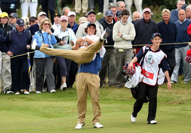 U.S. Walker Cup player Ricky Fowler is lifted in the air by Billy Horschel after Billy hit an approach shot to within a couple of feet of the hole during the foursomes match against Great Britain and Ireland at Royal County Down, Newcastle, Northern Ireland, Sunday, Sept. 9, 2007.