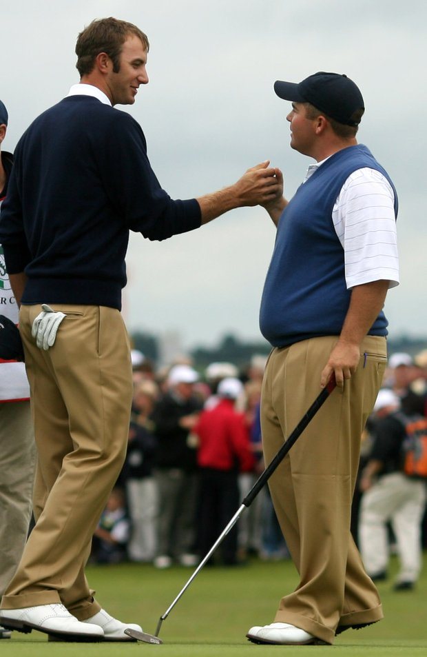 U.S. Walker Cup players Dustin Johnson, left, and Colt Knost celebrate after winning their foursomes match against Great Britain and Ireland at Royal County Down, Newcastle, Northern Ireland, Sunday, Sept., 9, 2007.