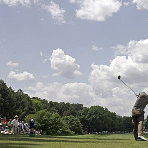 Anthony Kim hits his tee shot on the fourth hole during the final round of the Wachovia Championship golf tournament in Charlotte, N.C., Sunday, May 4, 2008.