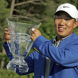 Anthony Kim raises the trophy after winning the Wachovia Championship golf tournament in Charlotte, N.C., Sunday, May 4, 2008.