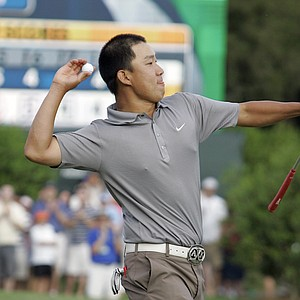 Anthony Kim throws his ball to the crowd after winning the Wachovia Championship golf tournament in Charlotte, N.C., Sunday, May 4, 2008.