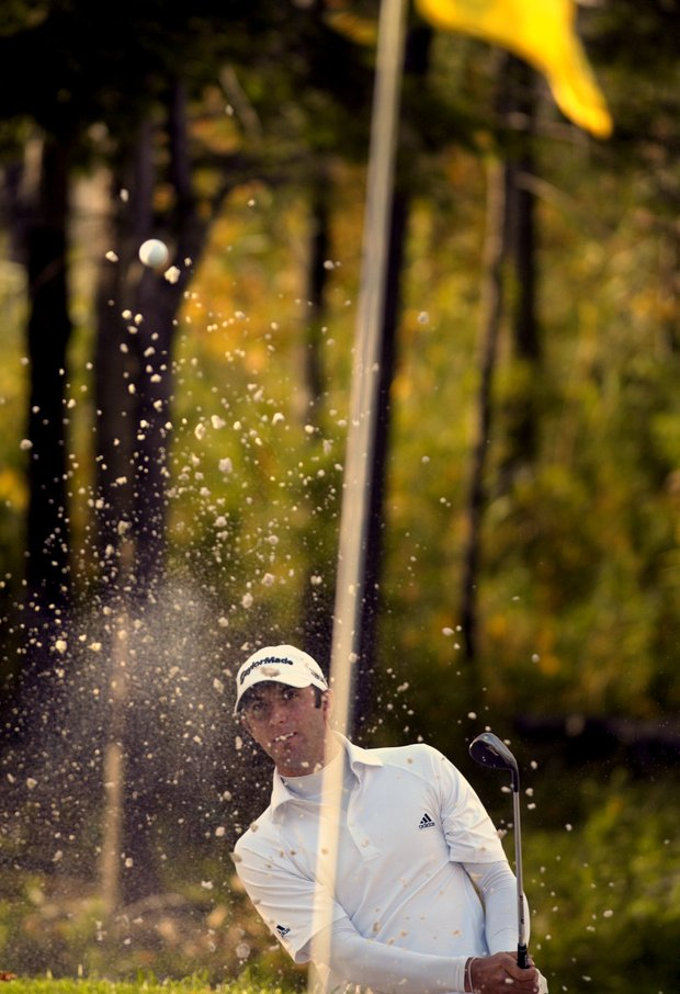 Dustin Johnson hits out of a sand trap on the 16th hole during the final round of the Turning Stone Resort Championship golf tournament in Verona, N.Y., Sunday, Oct. 5, 2008. Johnson won the tournament with a total 9-under par 279.