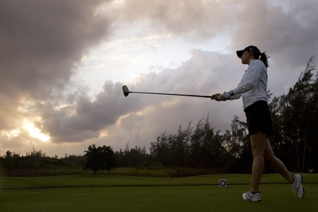 Michelle Wie drives off the 10th tee at sunrise during the second round of the SBS Open golf tournament at the Turtle Bay Resort, Friday, Feb. 13, 2009, in Kahuku, Hawaii. Wie finished at 2 under 70.
