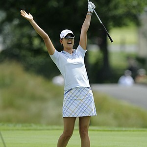 Michelle Wie celebrates her eagle from the first fairway during the final round of the LPGA Championship golf tournament, Sunday, June 14, 2009, in Havre de Grace, Md.