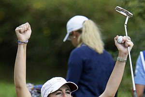 Team USA's Paula Creamer reacts in front of Team Europe's Suzann Pettersen of Norway after winning her singles match at the Solheim Cup golf tournament Sunday, Aug. 23, 2009, at Rich Harvest Farms in Sugar Grove, Ill.