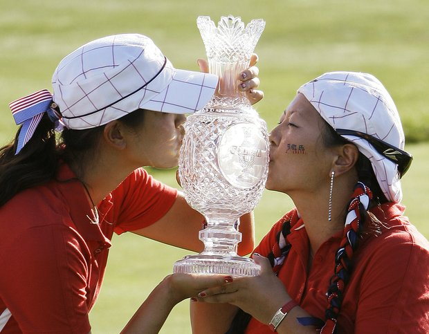 Team USA's Michelle Wie, left, and Christina Kim kiss the Solheim Cup after the golf tournament Sunday, Aug. 23, 2009, at Rich Harvest Farms in Sugar Grove, Ill. The USA team won 16-12 to retain the cup.