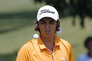 Rickie Fowler of Murrieta, Calif., tosses his ball in the air on the 11th green during the round of 64 at the U.S. Amateur Golf Championship in Tulsa, Okla., Wednesday, Aug. 26, 2009.