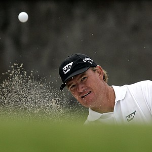 Ernie Els of South Africa hits the ball from a sand bunker at the 5th hole during Pro-Am golf of the 2009 HSBC Champions golf tournament Wednesday, Nov. 4, 2009, in Shanghai, China.