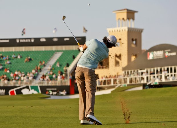 Rory McIlroy from Northern Ireland plays a ball on the 18th hole at the Earth course, Jumeirah Golf States during the first round of Dubai World Championship European Tour golf tournament in Dubai, United Arab Emirates, Thursday, Nov. 19, 2009.