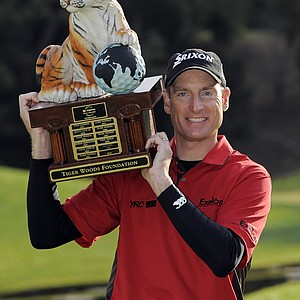 Jim Furyk holds up the tournament trophy after winning the Chevron World Challenge golf tournament at Sherwood Country Club, Sunday, Dec. 6, 2009, in Thousand Oaks, Calif.