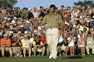 Lee Westwood of England acknowledges applause on the 18th hole after finishing his third round of the Masters golf tournament in Augusta, Ga., Saturday, April 10, 2010.