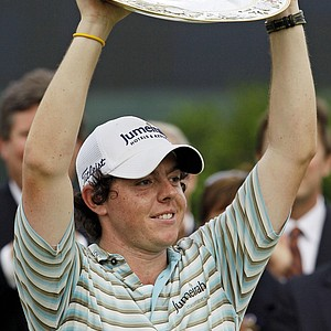 Rory McIlroy of Ireland holds the championship trophy after winning the Quail Hollow Championship golf tournament at Quail Hollow Club in Charlotte, N.C., Sunday, May 2, 2010. McIlroy, who celebrates his 21st birthday on Tuesday to become the youngest PGA Tour winner since Tiger Woods in 1996.